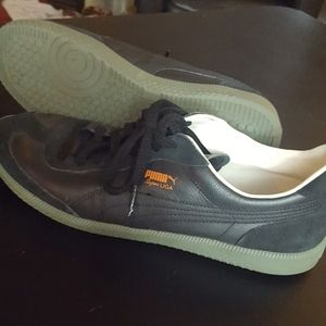 Black suede and leather Pumas